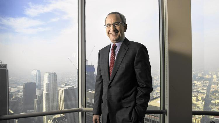 """Lloyd Greif, shown in his 65th-floor office in downtown L.A., is founder and CEO of the investment banking firm Greif & Co. """"I wasn't born with a silver spoon in my mouth,"""" he says. """"I grew up in a one-bedroom apartment."""" (Brian van der Brug / Los Angeles Times)"""